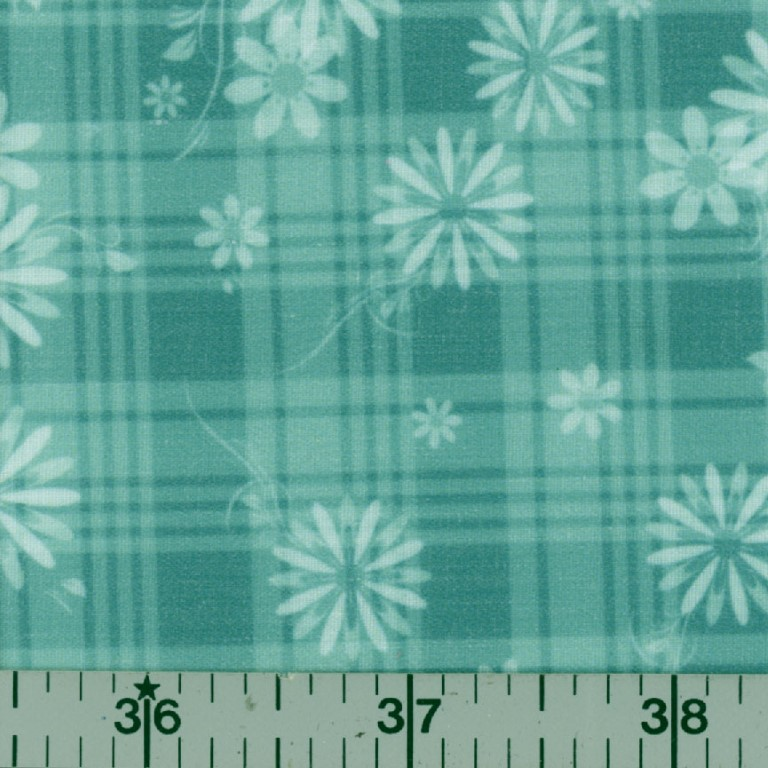 Teal fabric with a white floral pattern.