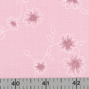 Pink fabric and pink and white flowers with vines.