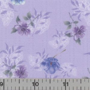 Lilac fabric with background plaid and blue and purple flowers.
