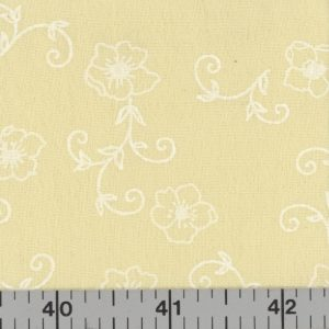 Yellow fabric with white flowers and vines.