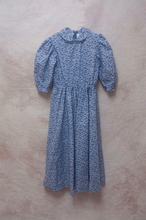 A gray dress with slate blue flowers.