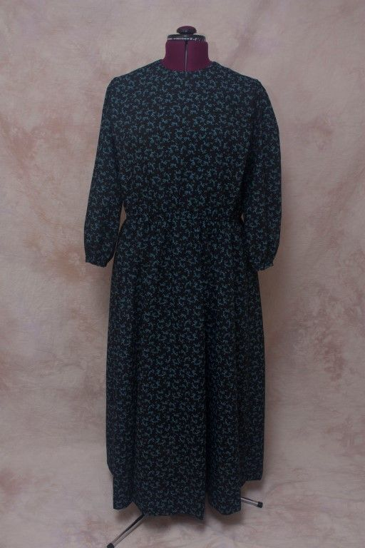 A black dress with a blue floral pattern.