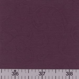 Grape fabric with embossed flowers and vines.