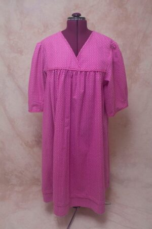 A fuschia night gown with white dots.