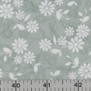 Green fabric with white flowers.