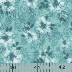 A green fabric with white flowers.