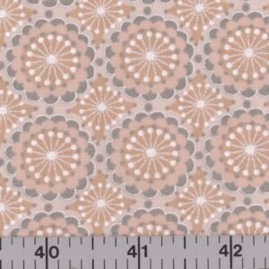 Peach fabric with gray and peach flowers.