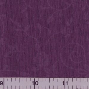 Plum fabric with embossed flowers.