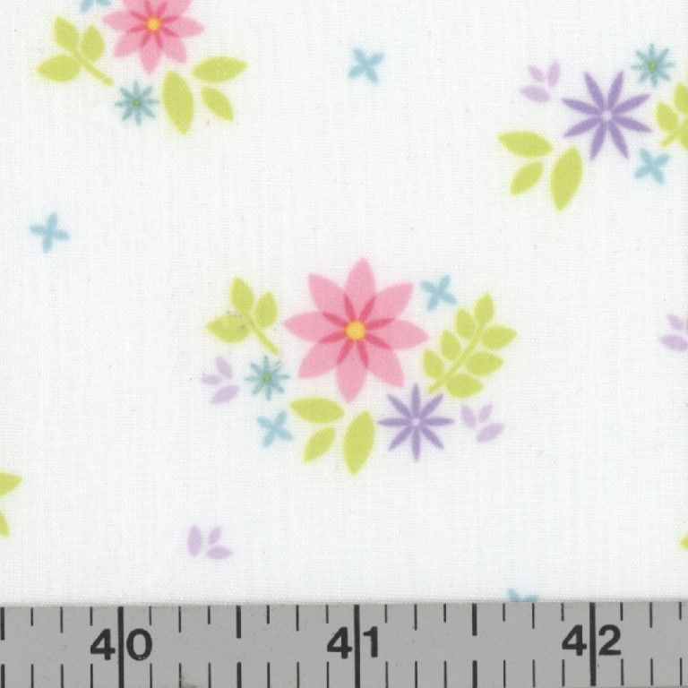 White fabric with pink, purple, and aqua flowers.